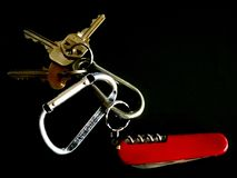 Key chain. With house keys and a pocket knife Stock Photography