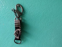 key chain leather on green wall concrete Stock Photo