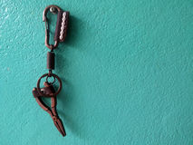 key chain leather on green wall concrete Royalty Free Stock Image