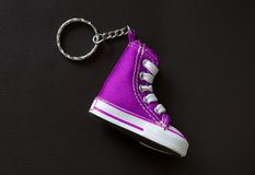 Key chain with mini basketball shoe Royalty Free Stock Photography