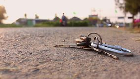 Key chain on road. Close up key chain on road stock video