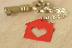 Key with a key chain in shape of house - Love for home concept. Key with a keychain in shape of house - Love for home concept Stock Image