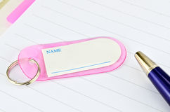 Key chain with space for text and blue pen Royalty Free Stock Image