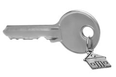 Key on a charm with the house. Royalty Free Stock Image
