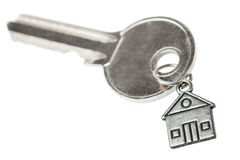 Key on a charm with the house. Stock Photo