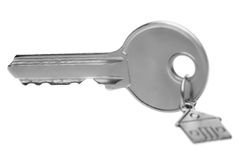 Key on a charm with the house. Royalty Free Stock Photo