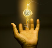 Key with clock on hand at light -  business concept Royalty Free Stock Images