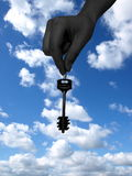 Key from the clouds kingdom. Key at human hand on cloudy background Stock Photos