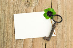Key and clover. White card with key and clover  on  board Stock Image