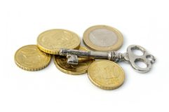 Key and coins Royalty Free Stock Images