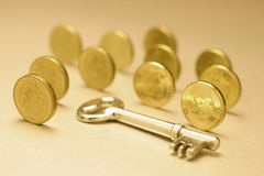 Key and Coins Stock Photography