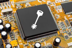 Key on computer chip Stock Photo
