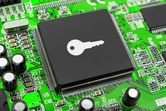 Key on computer chip Stock Image