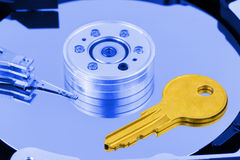 Key on computer hdd disk Royalty Free Stock Photography