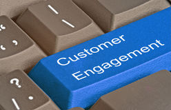 Key for customer engagement. Keyboard with key for customer engagement Royalty Free Stock Image