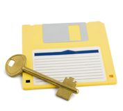 Key on diskette symbol protection Royalty Free Stock Images
