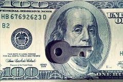 Key and dollar bill (corruption, lobbying, financial secrecy - c Royalty Free Stock Images