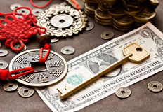Key on dollar with feng shui symbol Royalty Free Stock Photography