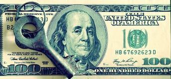 Key and dollars (corruption, lobbying, financial secrecy, loans Royalty Free Stock Photos