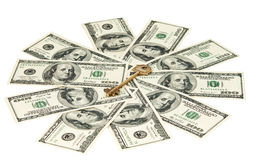 Key with dollars isolated Stock Photography