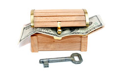 Key and dollars in the treasure chest Royalty Free Stock Photos