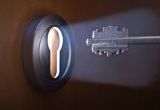 Key and door. Close up of key with keyhole Royalty Free Stock Images