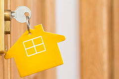 Key in a door lock. Key in a lock with house icon on it Royalty Free Stock Photography