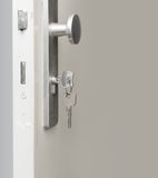 Key in Door Lock. Key in white Door Lock Stock Photos