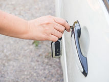 Key and door lock. Woman open door lock with key and electronic remote stock image
