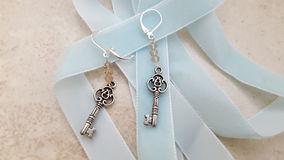 Key earrings. Hand Made key earrings with a blue ribbon Stock Image