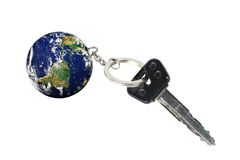Key with Earth as a keyring(part of the picture provided by NASA http://earthobservatory.nasa.gov) Stock Photos