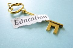 Key is education. Closeup of a key and paper note with Education text Royalty Free Stock Photo