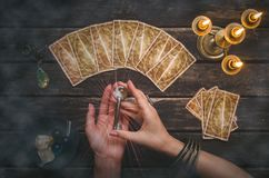Key of fate and tarot cards. Tarot cards on fortune teller desk table background. Magic key to secrets of fate. Futune reading concept. Divination royalty free stock photo