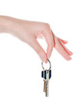 womans hand holding two keys Royalty Free Stock Photo