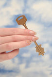 The key is in a female hand Royalty Free Stock Image