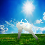 Key on field. New house idea Royalty Free Stock Photo