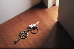 Open door with key. The key on the floor,and used to open door Royalty Free Stock Image
