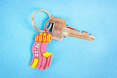 Key with funny house key ring. Over a blue background Stock Images