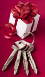 Key with the gift box. House key on a red background Royalty Free Stock Photos
