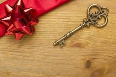 Key and gift ribbon Royalty Free Stock Photos
