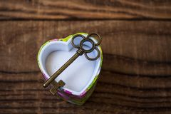 Key in a giftbox. On wooden background stock photo