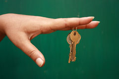 Key. Girl holding a bunch of keys Stock Photography