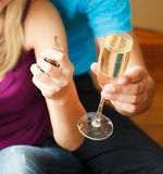 A key and a glass of champagne. Royalty Free Stock Images