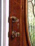 Key in Glass Door Royalty Free Stock Photo