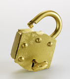 Key in Golden Padlock Stock Photo