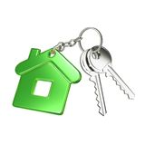 Key with green key chain. In form of house Royalty Free Stock Photos