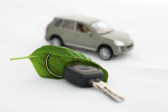 Key, green leave and a car.Ecology conception stock photo