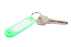 Key and green trinket. Royalty Free Stock Photo