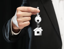 Key in hand. Key chain with key in hand  businessman Royalty Free Stock Image