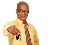 Key with hand. Image of a man holding a car key with white background Stock Photos